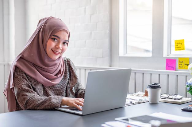 muslim-business-woman-brown-hijab-working-about-financial-with-business-report-calculator-home-office